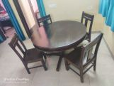 Review Atlas 4 Seater Round Dining Table (Walnut Finish)